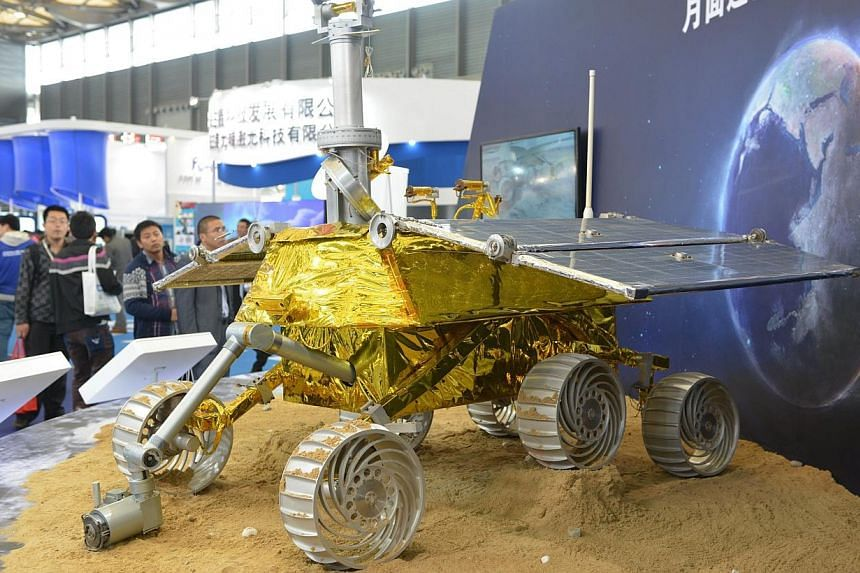 Model of a lunar rover named Jade Rabbit in a nod to Chinese folklore that will explore the moon's surface in an upcoming space mission is seen on display at the China International Industry Fair 2013 in Shanghai, on Nov 5, 2013.China's state m