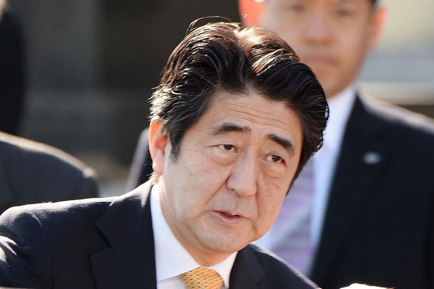Japanese Prime Minister Shinzo Abe (above) gets into a car after seeing off Emperor Akihito and Empress Michiko for their trip to New Delhi, at Haneda Airport in Tokyo, on Saturday, Nov 30, 2013.Mr Abe said on Sunday he would discuss China's ex