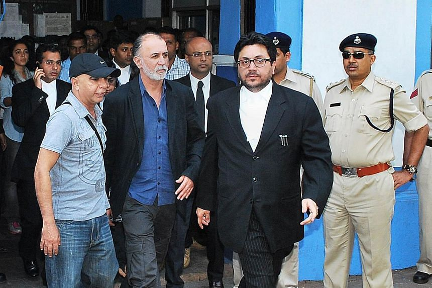 Indian magazine editor Tarun Tejpal (second left) is escorted by officials as he leaves a session court in Panaji, on Saturday, Nov 30, 2013. MrTejpal was remanded in custody on Sunday after appearing in court on allegations of sexually assault