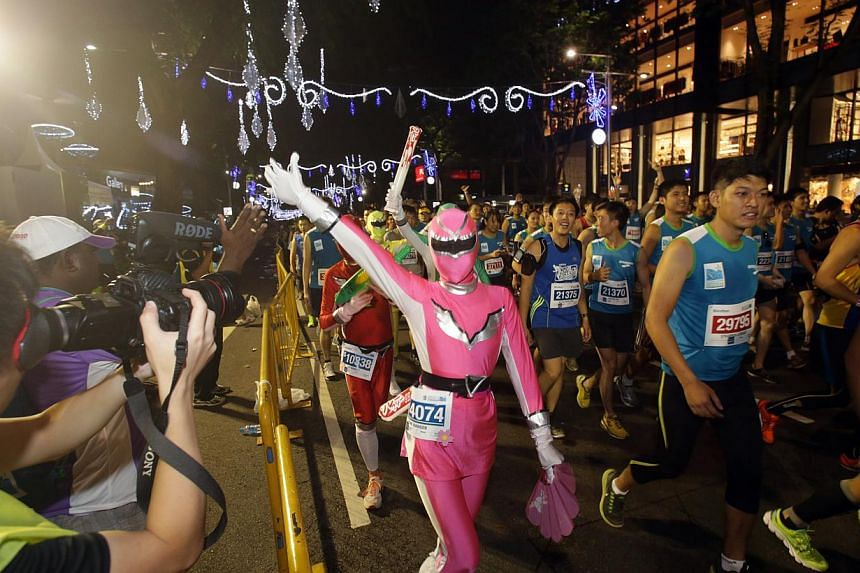 A group of full marathon participants dressed as Power Rangers commenced their race in the Standard Chartered Marathon 2013 on Dec 1. -- ST PHOTO: KEVIN LIM