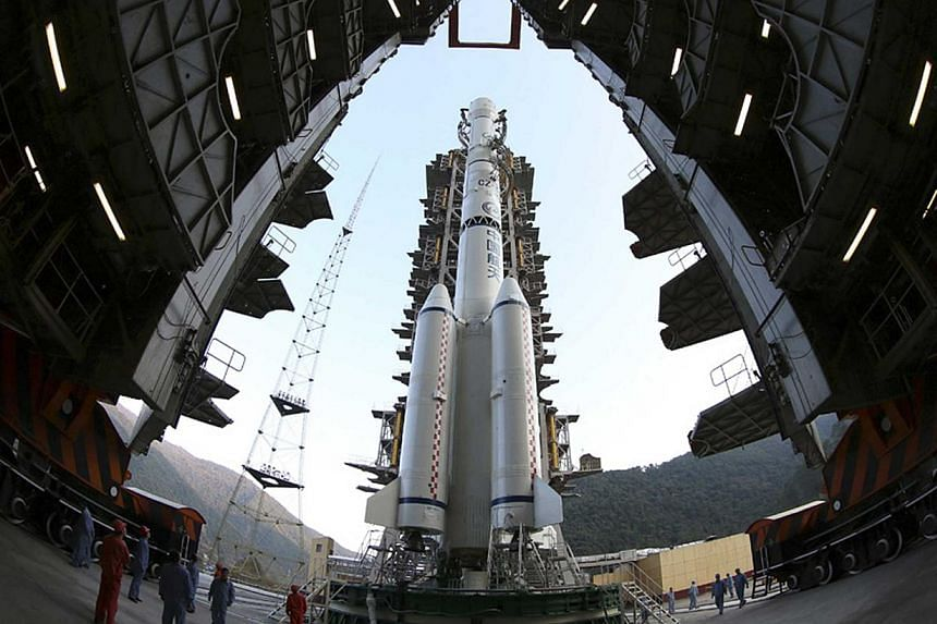 The Long March 3B rocket carrying the Chang'e-3 lunar probe is seen docked at the launch pad at the Xichang Satellite Launch Center in Liangshan, Sichuan province December 1, 2013.China launched its first moon rover mission early on Monda