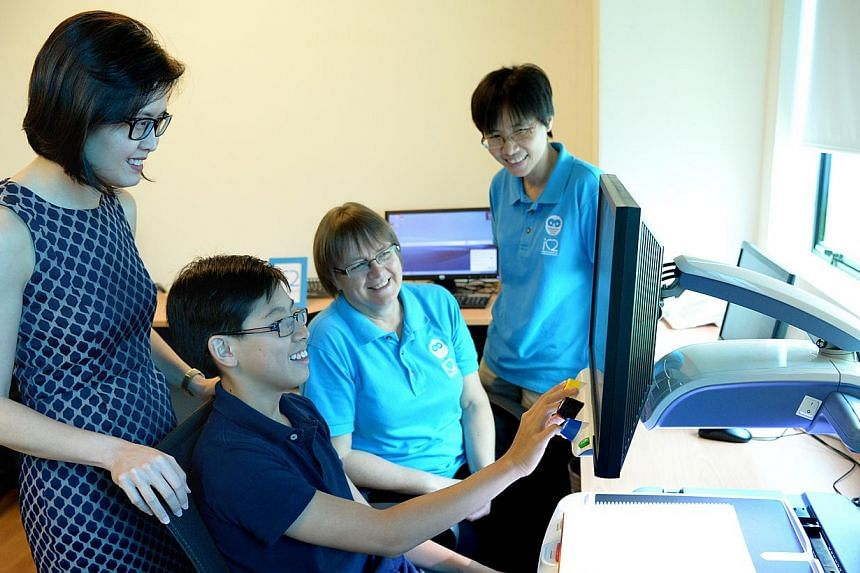 Dr Audrey Looi (from left), with her son James Ang, principal trainer Mary McPherson and teacher Lee Lay Hong at iC2 Prephouse, which helps young people and children who are visually impaired.