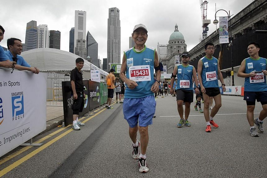 Mr Chan Meng Hui, the oldest participant of the full marathon at age 83, is all smiles after crossing the finish line under seven hours in theStandard Chartered Marathon 2013 on Sunday, Dec 1, 2013. -- ST PHOTO:KEVIN LIM