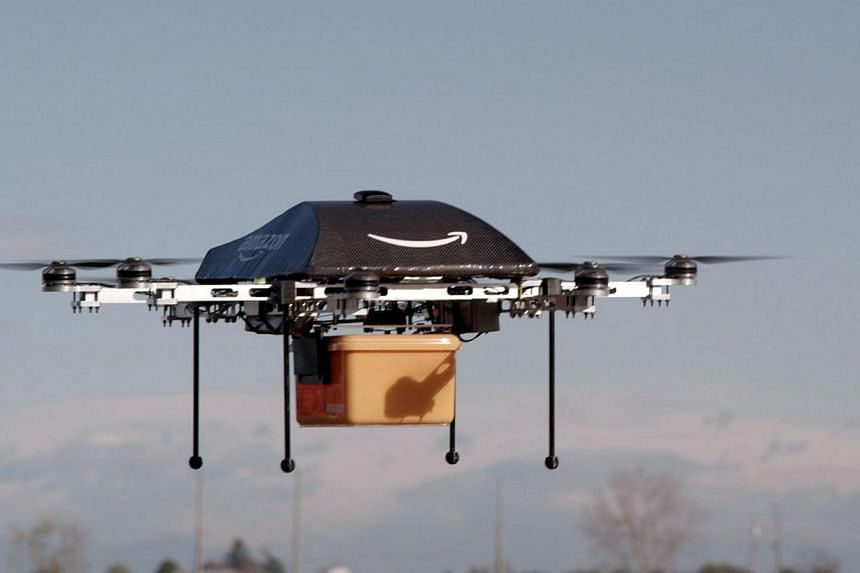 This undated handout photo released by Amazon on Sunday, Dec 1, 2013, shows a flying octocopter mini-drone that would be used to fly small packages to consumers. Amazon CEO Jeff Bezos revealed on Sunday that his company is looking to the future with