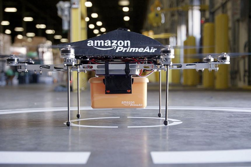 This undated handout photo released by Amazon on Sunday, Dec 1, 2013, shows an octocopter mini-drone that would be used to fly small packages to consumers. -- PHOTO: AFP / AMAZON