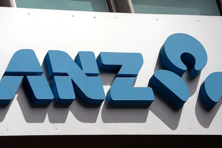 ANZ bank signage is displayed in central Sydney on Dec 2, 2013. Australia's largest ever consumer class action in which bank customers are fighting for the return of more than A$240 million ($$274 million) in fees began in Melbourne on Monday. -- PHO
