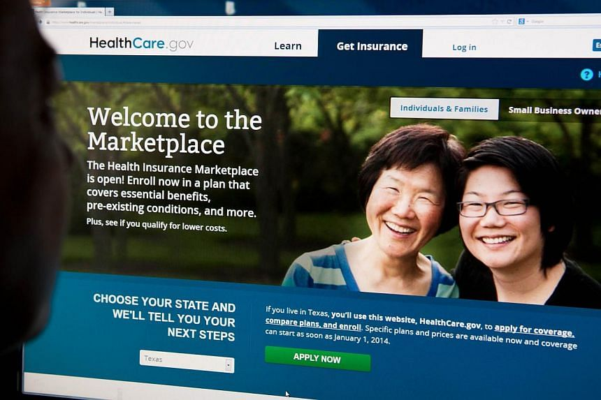 A woman looks at the HealthCare.gov insurance exchange internet site in this Oct 1, 2013 file photo in Washington, DC. Two months after the disastrous launch of a website that is a key component of President Barack Obama's healthcare law, administrat