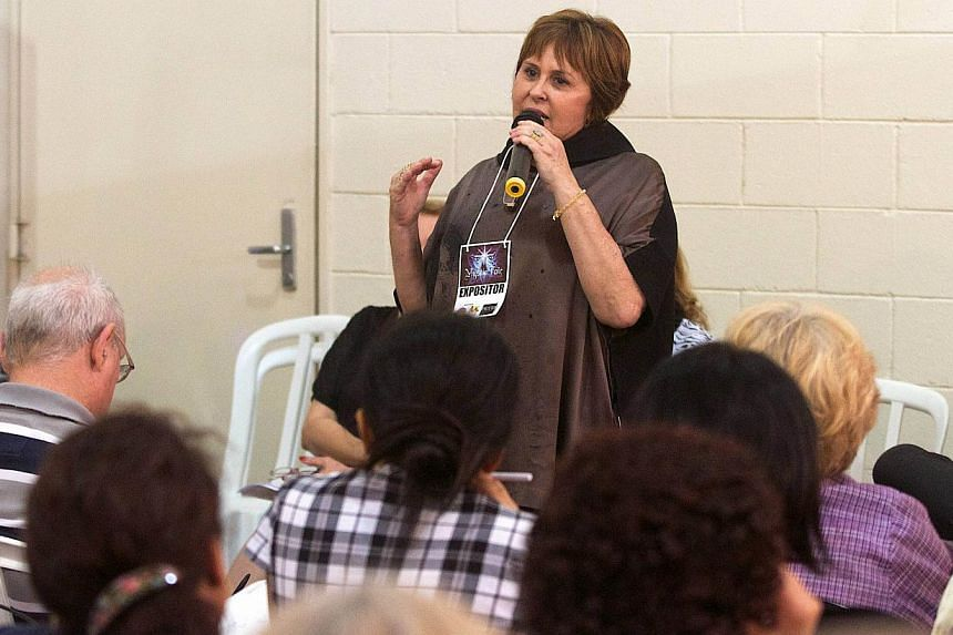 Brazilian Marcia Fernandes speaks during the 4th Mystic Fair, in Sao Paulo, Brazil, on Dec 1, 2013. If Fernandes is proven right, millions of Brazilians will be sorely disappointed next July as she forecast a German victory in the final of the World