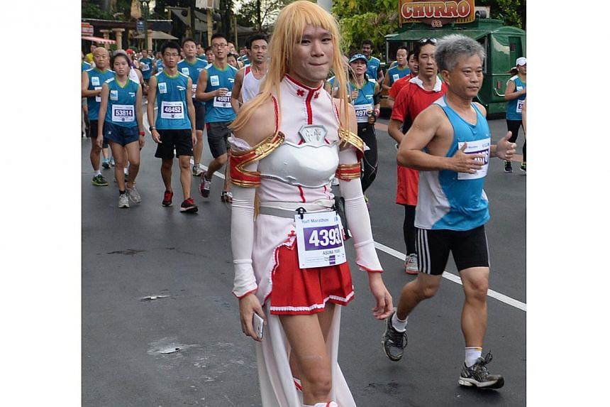 A runner dressed as a manga character at the Standard Chartered Marathon 2013 on Sunday morning, Dec 1. -- ST PHOTO: RAJ NADARAJAN