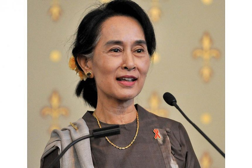 Myanmar opposition leader Aung San Suu Kyi speaks at a World AIDS Day function at Government House in Melbourne on Dec 1, 2013. Suu Kyi called on World Aids Day Sunday for an end to discrimination against those living with the disease as experts warn