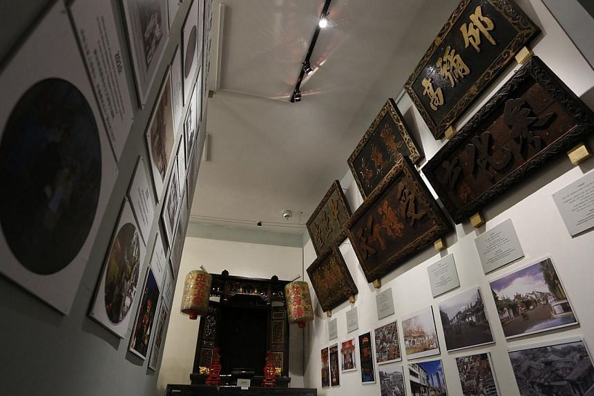 Taoist Mission president Lee Zhiwang in the Singapore Yu Huang Gong temple and the heritage gallery (above). The mission wants to raise awareness about the building's heritage. -- PHOTO: DESMOND LUI FOR THE STRAITS TIMES