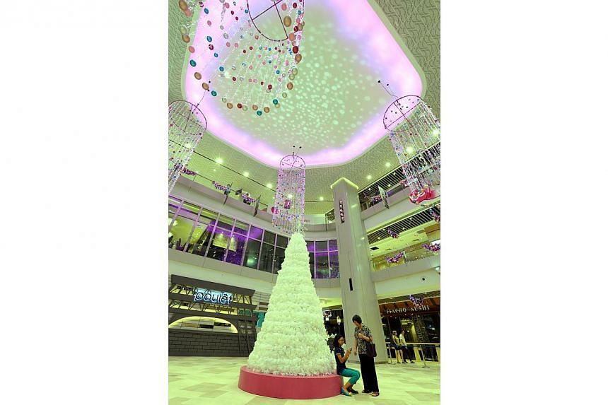 A photo of Bedok Mall's Christmas tree, a one-of-a-kind, environmentally friendly Christmas tree crafted from some 2,000 recycled plastic milk bottles. -- ST PHOTO: AZIZ HUSSIN