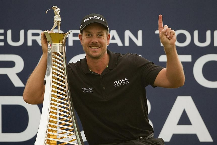 Henrik Stenson of Sweden poses with his 2013 Race to Dubai trophy after winning the DP World Tour Championship in Dubai on Nov 17, 2013. Stenson still has concerns about his long-standing wrist problem as the Swede prepares to return to competit