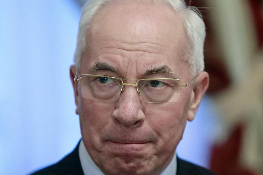 Ukrainian Prime Minister Mykola Azarov (above) apologised on Tuesday, Dec 3, 2013, for a brutal police crackdown on Kiev protests over the weekend that drew firm Western condemnation and sparked even bigger rallies. -- FILE PHOTO: REUTERS