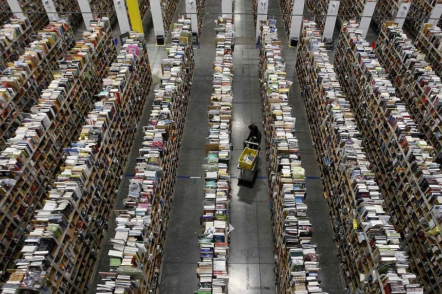 A worker gathers items for delivery from the warehouse floor at Amazon's distribution center in Phoenix, Arizona in this Nov 22, 2013, file photo. US online sales are expected to hit US$2 billion (S$2.5 billion) on Cyber Monday, for the first ti