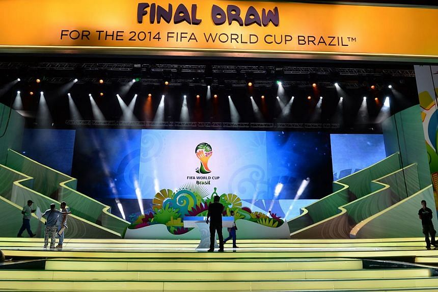 Workers put finishing touches to the stage where the Brazil 2014 FIFA World Cup final draw will take place, in Costa do Sauipe, state of Bahia, on Dec 2, 2013. Just four days before the draw for the 2014 World Cup, Fifa faced yet another embarra