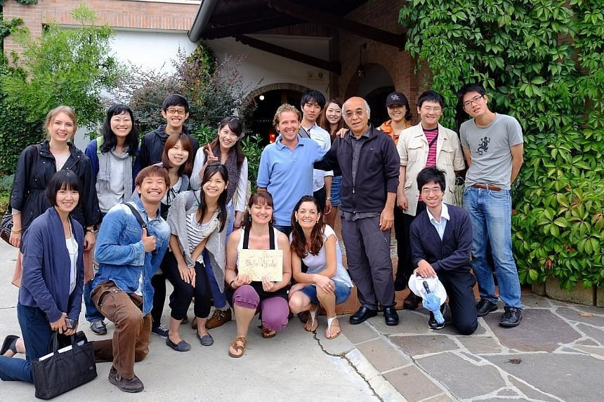 Polish student Anna Wozny (standing, left) has made a smooth transition to campus life in Japan. The 22-year-old now hangs out with Japanese friends that she came to know while on a school trip to Italy in summer. -- PHOTO: COURTESY OFANNA WOZN