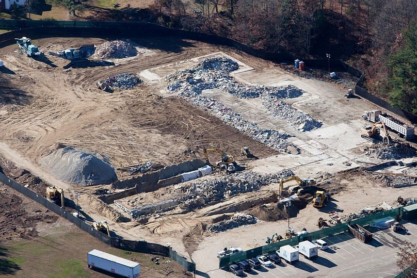 An aerial photo showing demolition work near completion at Sandy Hook Elementary School in Newtown, Connecticut on Nov 13, 2013, the site where a gunman killed 20 children and six adults before taking his own life last December. The 911 recordin