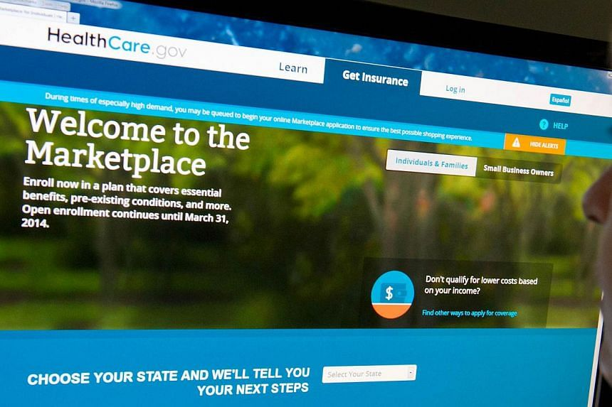 This Dec 2, 2013 photo shows a woman reading the HealthCare.gov insurance marketplace internet site in Washington, DC. President Barack Obama will try to sell the American people on the relaunch of his troubled healthcare program on Tuesday in a bid