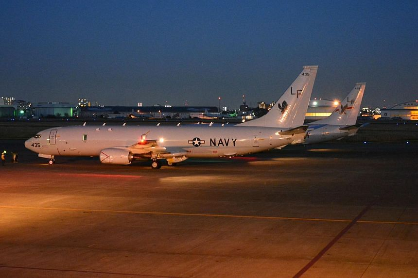 This Dec 1, 2013 US Navy handout image shows Patrol Squadron (VP) 16's P-8A Poseidon No. 429 and No. 435 aircraft refueling at Naval Air Facility Atsugi in Ayase, Japan.The United States Navy's first two advanced patrol aircraft have arrived in
