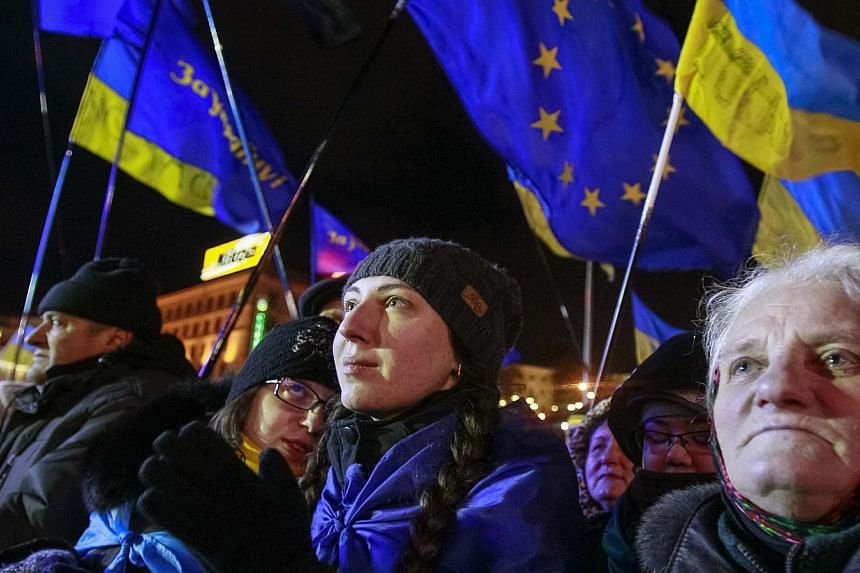 People supporting European Union (EU) integration attend a rally in Kiev on Dec 2, 2013. Ukrainian protesters blockaded the main government building on Monday, seeking to force President Viktor Yanukovich from office with a general strike after hundr