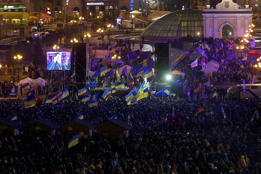 Protesters gather during a rally at the central Independence square in Kiev, Ukraine, on on Dec 2, 2013. Thousands of protesters besieged government buildings in Ukraine's capital on Monday to demand the ouster of the Prime Minister and his Cabinet,