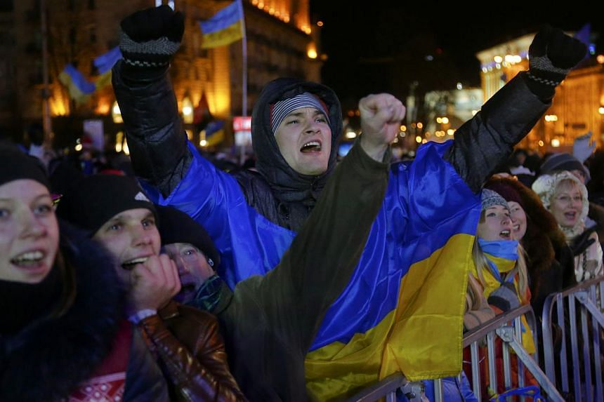 Ukrainians shout during a rally at the central Independence square in Kiev, Ukraine, on Dec 2, 2013. Thousands of protesters besieged government buildings in Ukraine's capital on Monday to demand the ouster of the Prime Minister and his Cabinet, as a