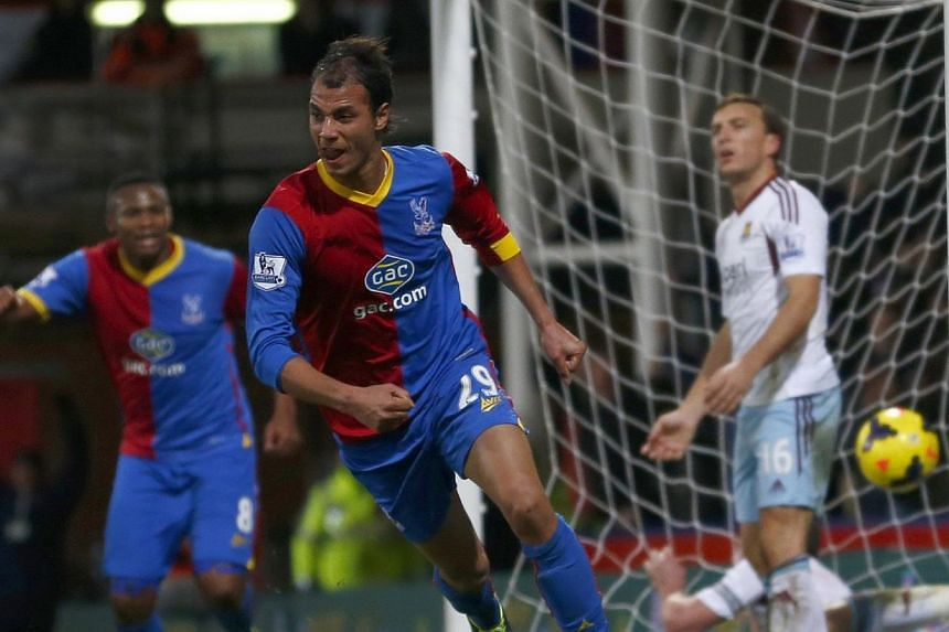 Crystal Palace's Marouane Chamakh (left) scores a goal against West Ham during their English Premier League soccer match at Selhurst Park in London on Dec 3, 2013. Chamakh's goal took Crystal Palace off the bottom of the Premier League table as they