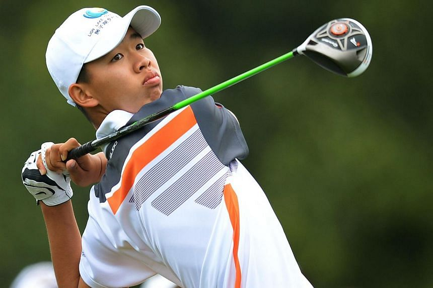 This file photo taken on April 14, 2013 shows Guan Tianlang of China hitting a drive during the fourth round of the 77th Masters golf tournament at Augusta National Golf Club in Augusta, Georgia.  A wave of child prodigies is emerging in China,