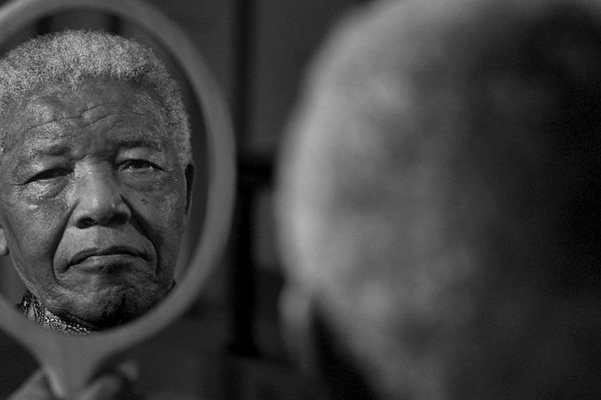 Former South African President Nelson Mandela's face reflected on a mirror, taken on Sept 13, 2011 by photographer Adrian Steirn.South Africa's ailing first black President Mandela is still teaching life lessons and remains a fighter even as he