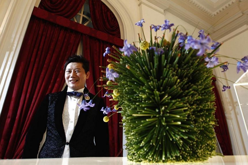 Mr Harijanto and his work, Furry Botany, on display at the Istana for the President's Design Award prize ceremony last night. -- ST PHOTO: NEO XIAOBIN