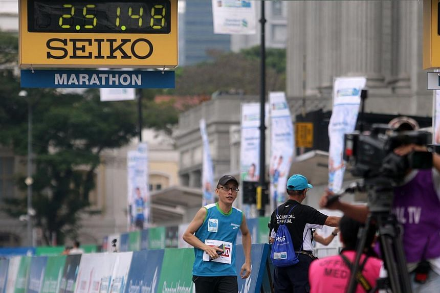 Attempts to contact Tam Chua Puh, seen here crossing the finishing line at the Standard Chartered Marathon, have proven unsuccessful. He was said to have finished some seven minutes faster than Singapore's top marathoner Mok Ying Ren but he was later