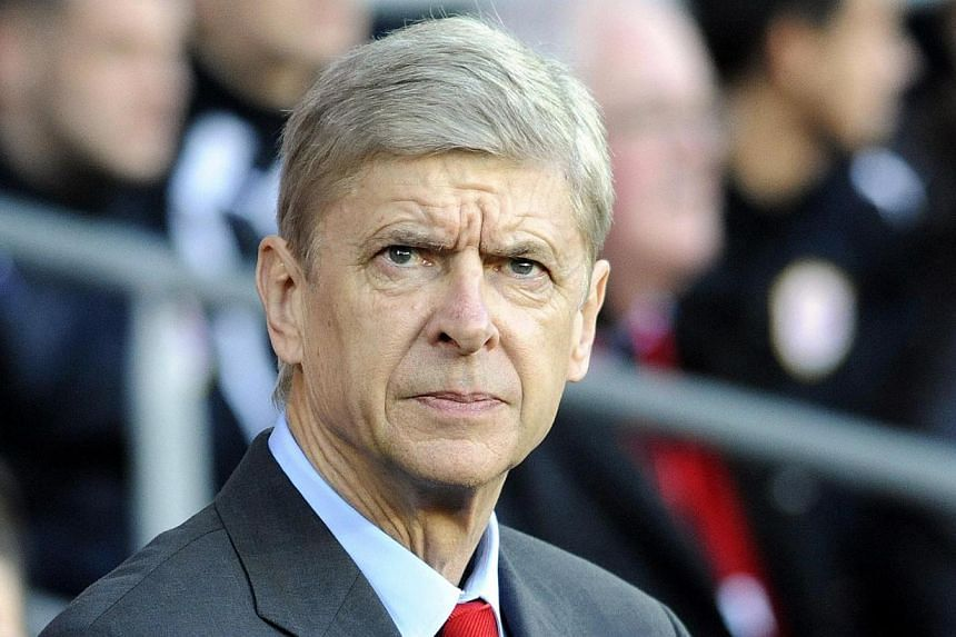 Arsenal manager Arsene Wenger (above) says he does not mind that some television pundits have written off his side's chances of going the distance in this season's English Premier League title race. -- FILE PHOTO: REUTERS