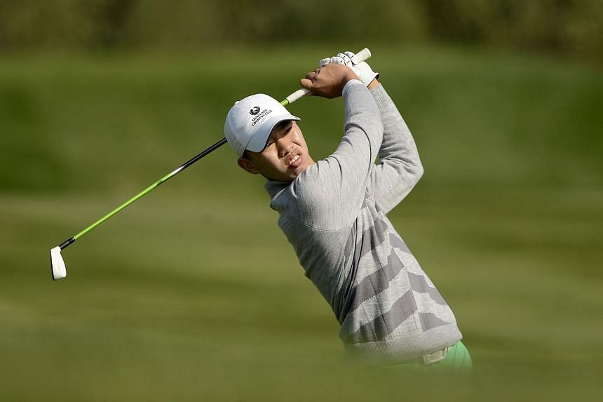 This handout photo taken and received on Oct 26, 2013, by the Asia Pacific Amateur Championship (AAC) shows Guan Tianlang of China hitting a shot during round three of the Asia-Pacific Amateur Championship at Nanshan International Golf Club in Longko