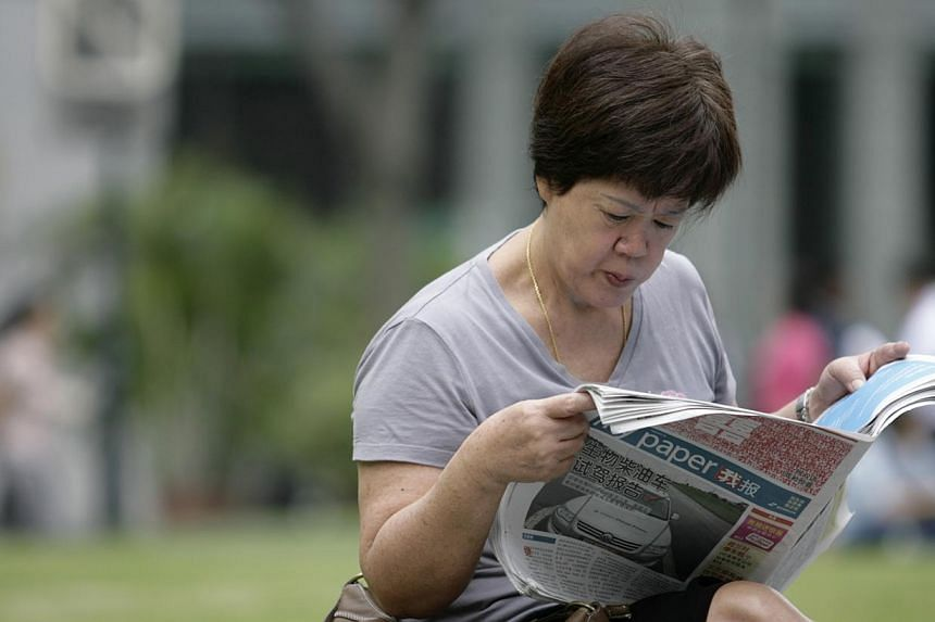 A reader reading the new bilingual MyPaper at Raffles Place MRT. Keep an eye out for the new-look MyPaper on Thursday, Dec 5, 2013. Readers of Singapore's first and only bilingual newspaper can look forward to several changes. -- MYPAPER FILE PH