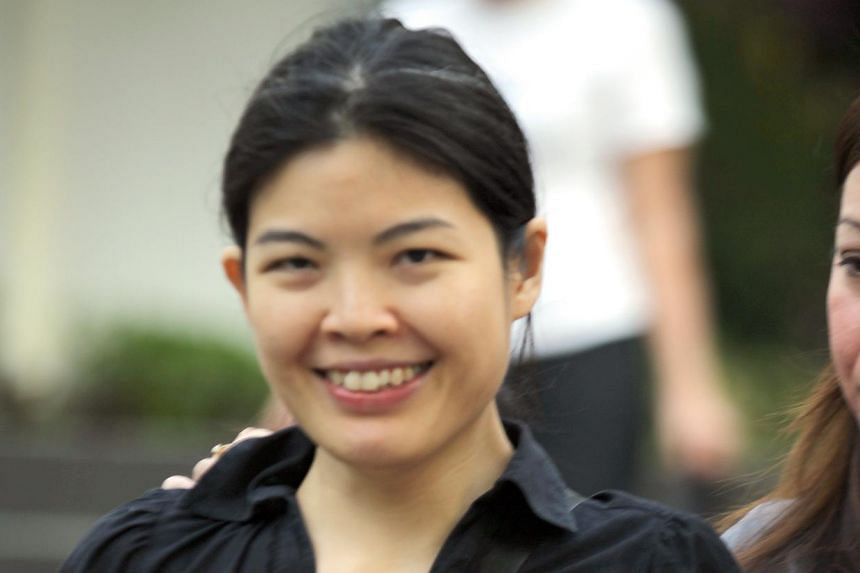 Former AIA agent Sally Low Ai Ming (above) pleaded guilty to four of the 19 charges involving a fake policy she had sold to her client over a decade ago. The other 15 charges will be taken into consideration when she is sentenced. -- ST PHOTO:W