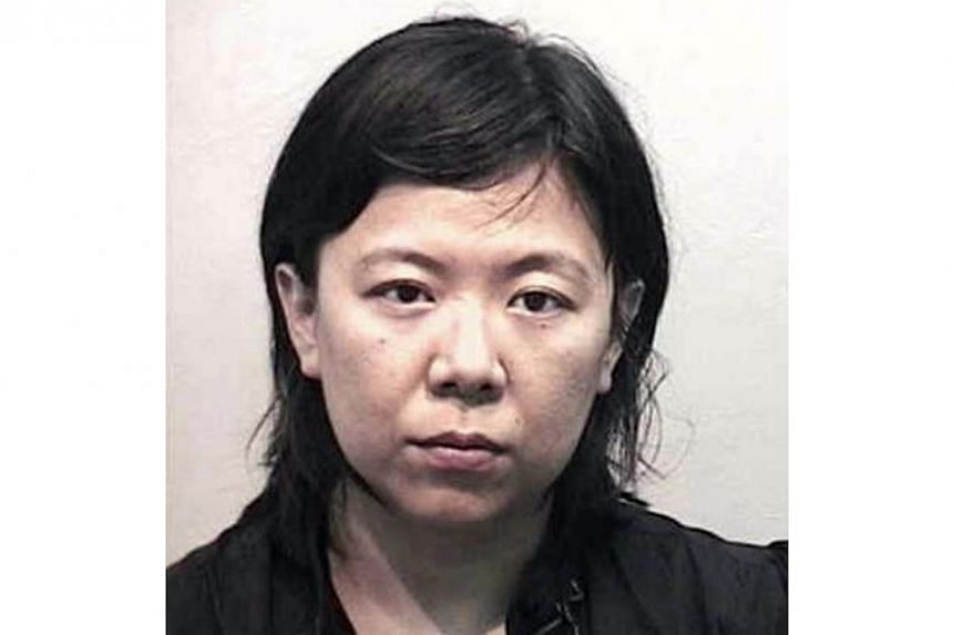 Wee Yat Mui (above), 39, who stole her elder sister's credit cards and identity card, and went on to commit a series of offences, was jailed for 27 months on Wednesday, Dec 4, 2013. -- PHOTO: SINGAPORE POLICE FORCE