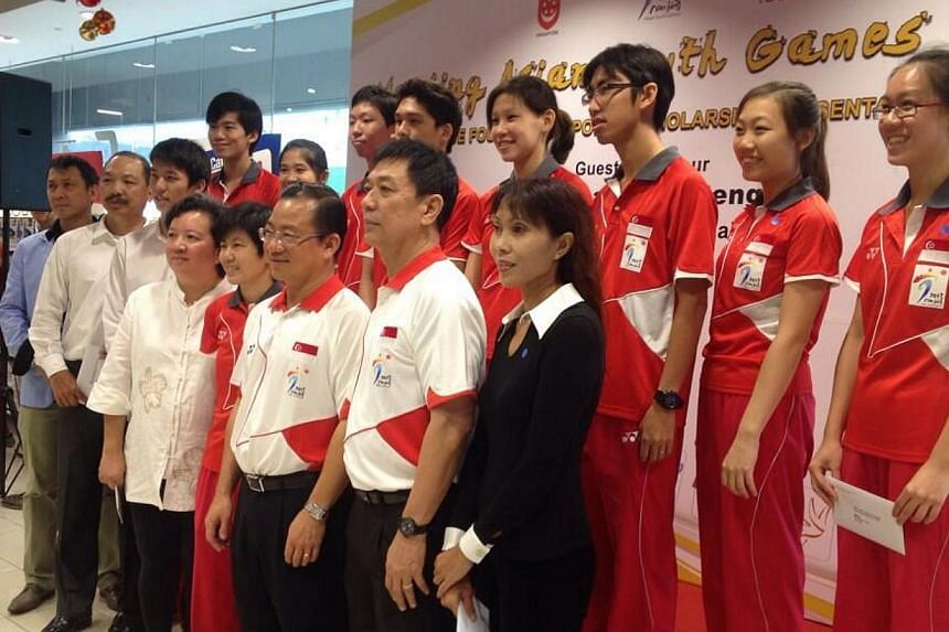 Singapore's medallists from this year's Asian Youth Games receiving scholarships from NTUC FairPrice Foundation. -- ST PHOTO: MAY CHEN
