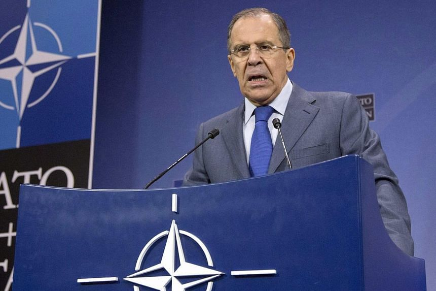 Russia's Foreign Minister Sergei Lavrov addresses a news conference after a NATO-Russia foreign ministers meeting at the Alliance headquarters in Brussels, on Dec 4, 2013. Russian Foreign Minister Sergei Lavrov, on Wednesday, Dec 4, 2013, accused Nat