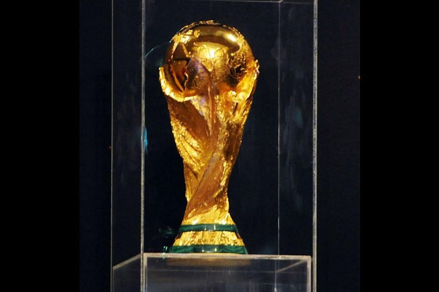 The World Cup trophy is pictured during the Fifa World Cup Trophy Tour on Nov 21, 2013, in Algiers. The prize money at next year's World Cup finals will be increased by at least a third from that on offer in South Africa in 2010, Fifa general se