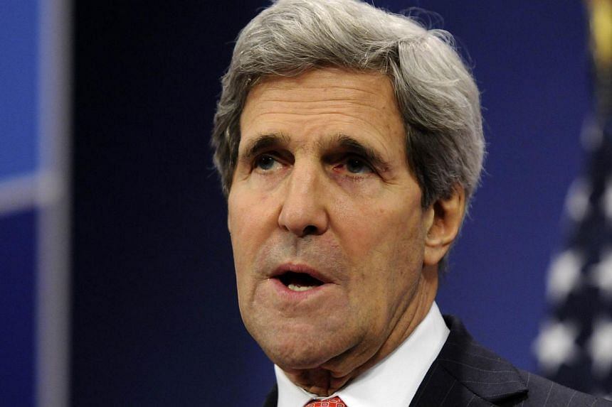 US Secretary of State John Kerry talks to the media following the Nato Foreign Affairs Ministers meeting held at Nato headquarters in Brussels, Dec 3, 2013. Ukrainians should be allowed to choose their own future, Mr Kerry said on Wednesday, aft
