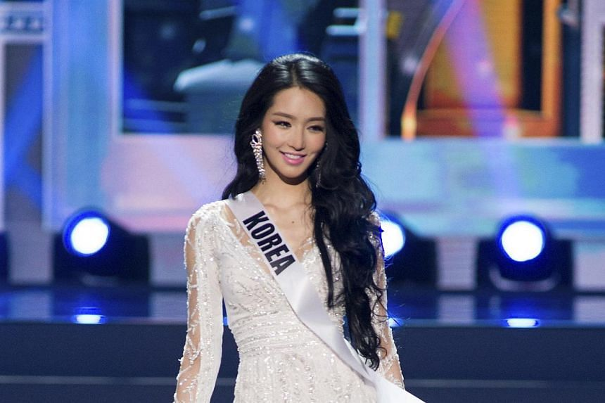 Miss Kim Yumi, South Korea's representative, catwalks in her evening gown during the preliminary round of Miss Universe 2013 in Moscow, Russia, on November 5. The Miss Korea 2012 winner confessed to having gone under the knife last July. -- PHOTO: AF