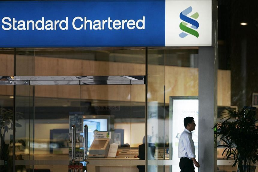 Close to 650 Standard Chartered private bank clients in Singapore have had their information stolen, the bank said on Thursday, Dec 5, 2013. -- ST FILE PHOTO:LIM WUI LIANG