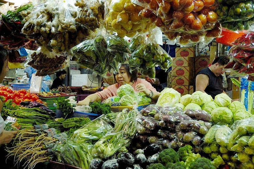 Consumers are paying more for some fruit and vegetables from Malaysia, where floods have sent some farms under water. -- FILE PHOTO: BLOOMBERG