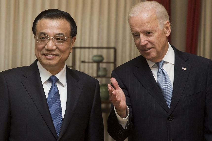 United States (US) Vice-President Joe Biden (right) introduces his delegation members to Chinese Premier Li Keqiang before heading to their meeting at the Zhongnanhai diplomatic compound in Beijing on Dec 5, 2013. Not a word was made publicly about C