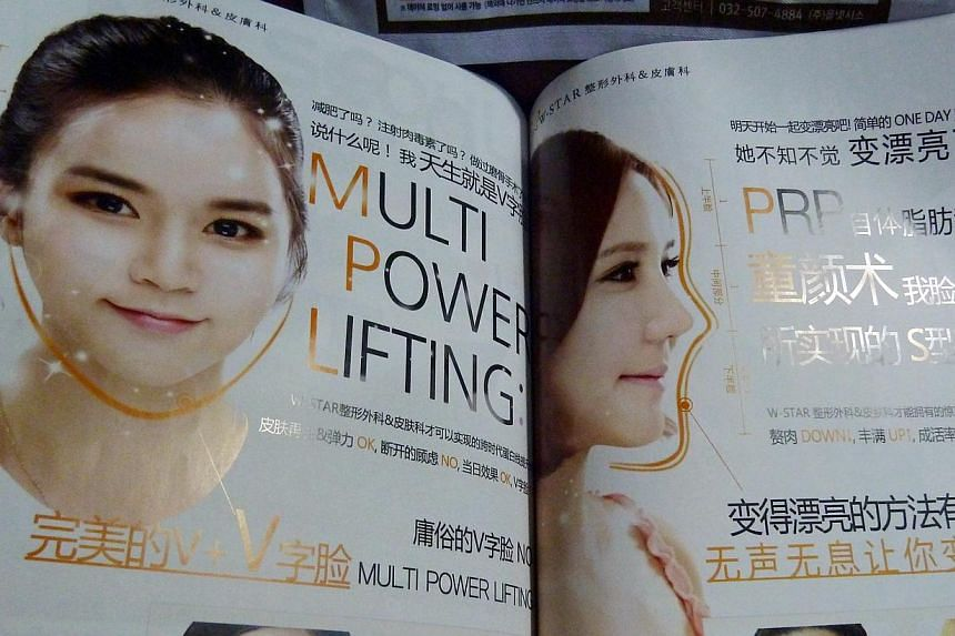 Travellers can find information on a host of plastic surgery clinics in this booklet that they can pick up from the seat pockets in the airport limousine bus in Seoul, South Korea. -- ST PHOTO: CHEONG POH KWAN