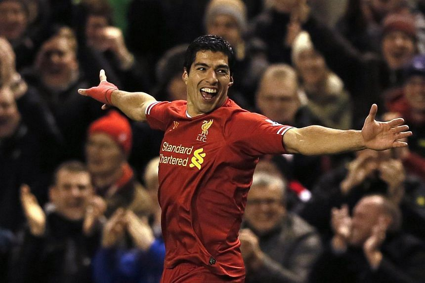 Liverpool's Luis Suarez celebrates scoring a goal against Norwich during their English Premier League soccer match at Anfield in Liverpool, northern England, on Dec 4, 2013. Suarez led a one-man demolition of Norwich City with four goals in a 5-1 win