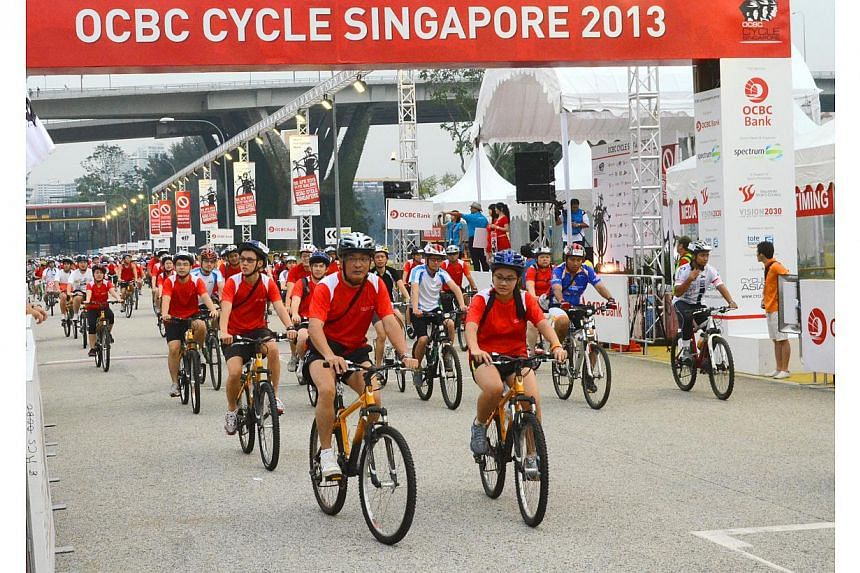 Nearly 10,000 participants rode in the OCBC Cycle Singapore, Singapore's largest mass participation cycling event, held at the F1 pit building on April 28, 2013. OCBC Cycle Singapore 2014 was officially launched on Dec 5, 2013. -- ST FILE PHOTO: NURJ