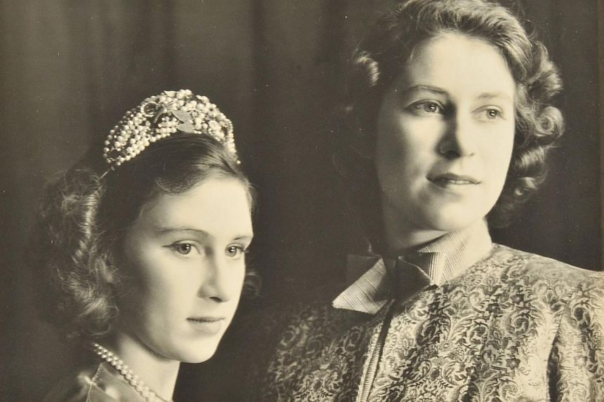 A handout reproduction picture released by Dominic Winter Auctioneers on Dec 4, 2013 shows a photograph of the then Princess Elizabeth (right), now Queen Elizabeth II, and Princess Margaret (left) in the play Aladdin at the Royal School in Windsor in