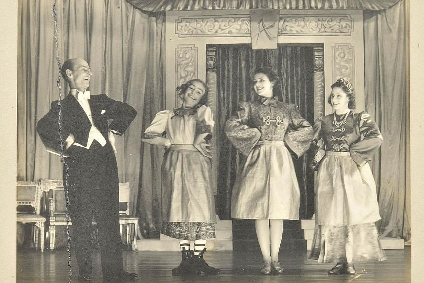 A handout reproduction picture released by Dominic Winter Auctioneers on Dec 4, 2013, shows a photograph of the then Princess Elizabeth (second, right), now Queen Elizabeth II, and Princess Margaret (right) in the play Aladdin at the Royal School in